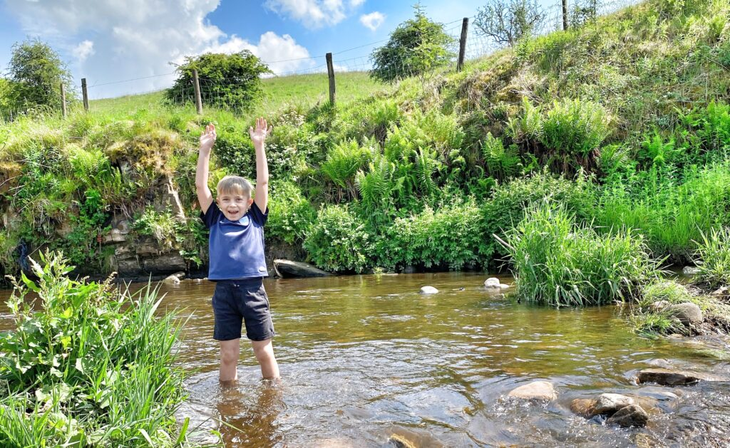 boy playing in river